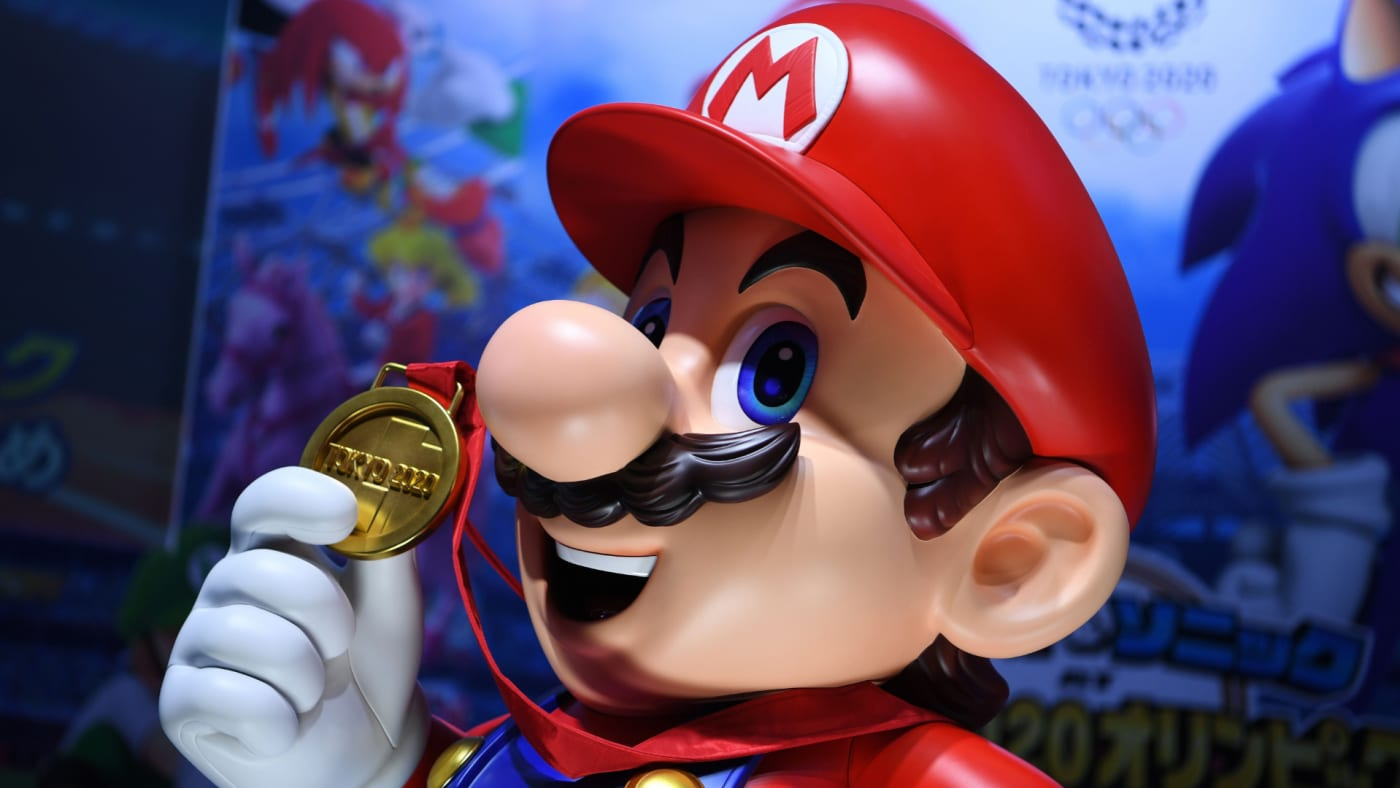 "Mario is seen at a promotional booth for ""Mario & Sonic at the Olympic Games Tokyo 2020."""