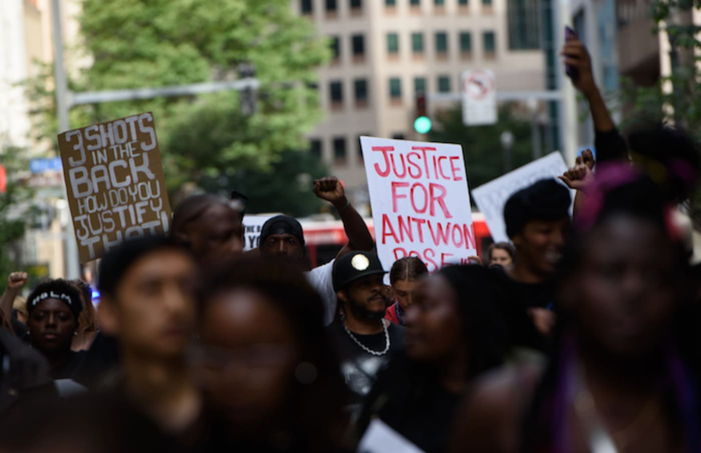 Protestors at a rally asking for justice for Antwon Rose.