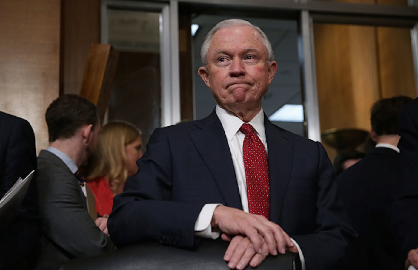 Jeff Sessions, a committee member, waits for the beginning of a meeting