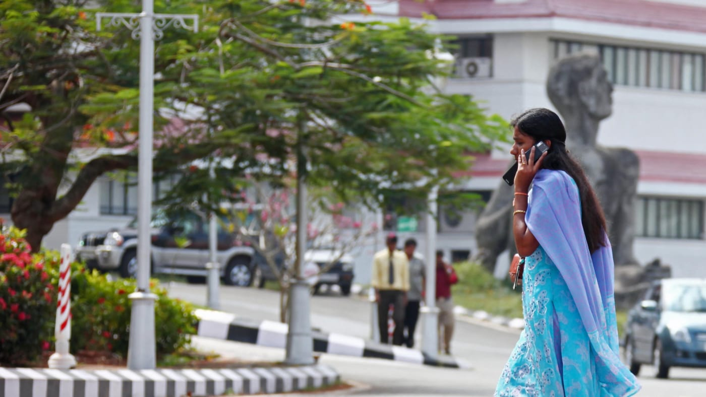 Indian businesswoman with a mobile phone at the center of technology in Kerala called technopark.