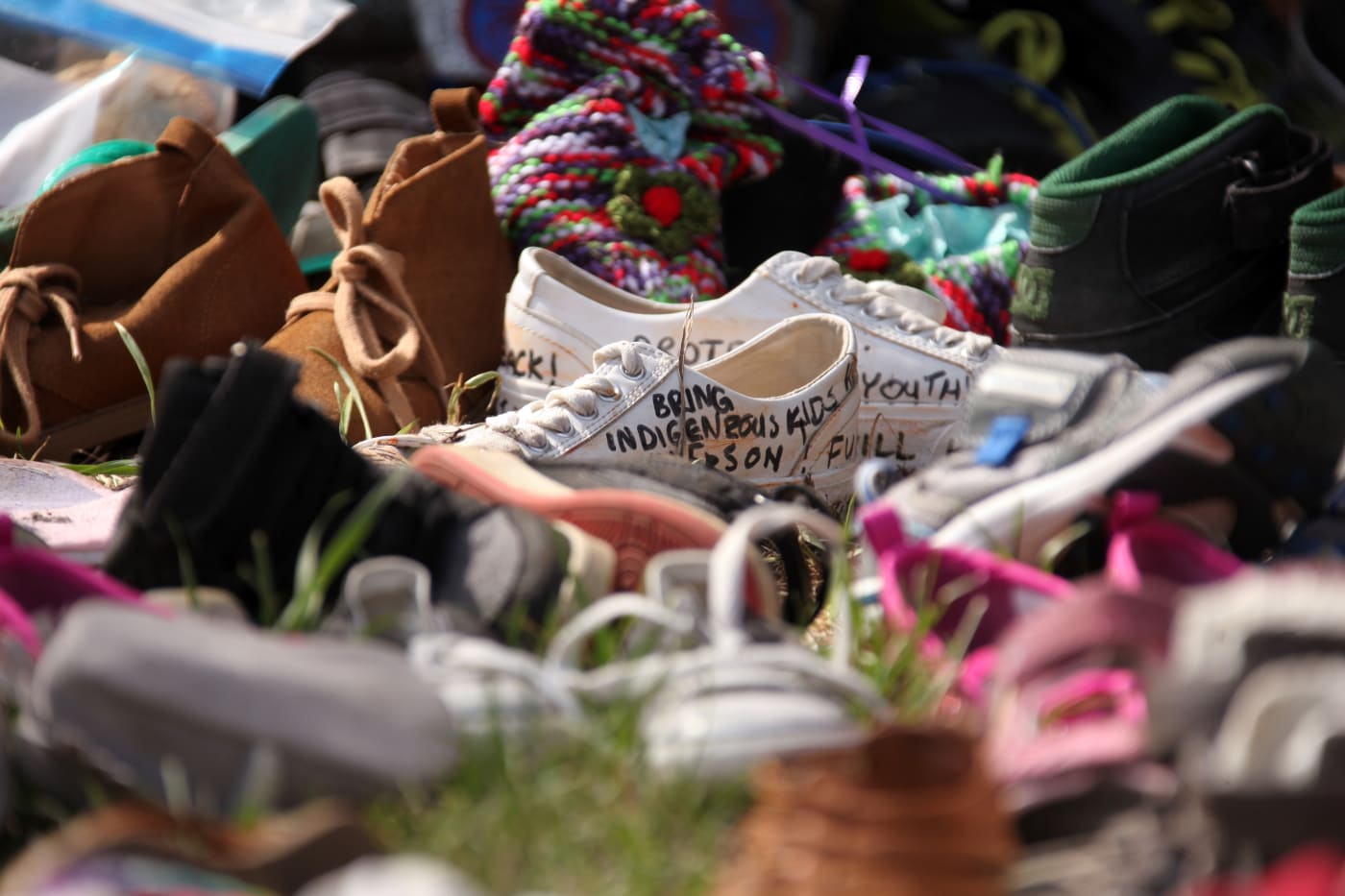Shoes are placed at Ryerson Univerisity to mourn 215 indigenous children whose remains were discovered at a former residential school on June 7, 2021 in Toronto, Canada.