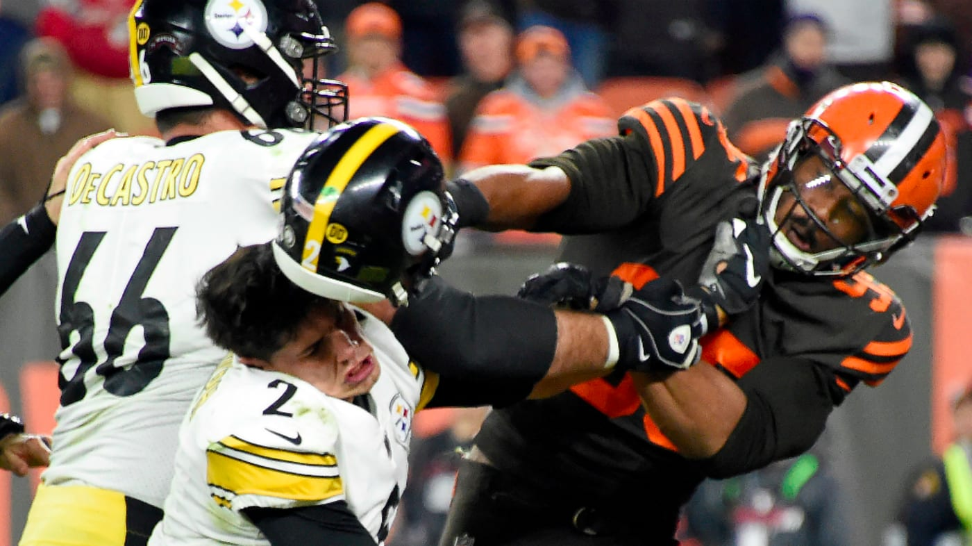 Defensive end Myles Garrett of the Cleveland Browns hits Quarterback Mason Rudolph
