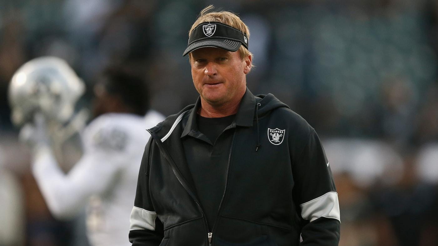 Head coach Jon Gruden of the Oakland Raiders walks on the field.