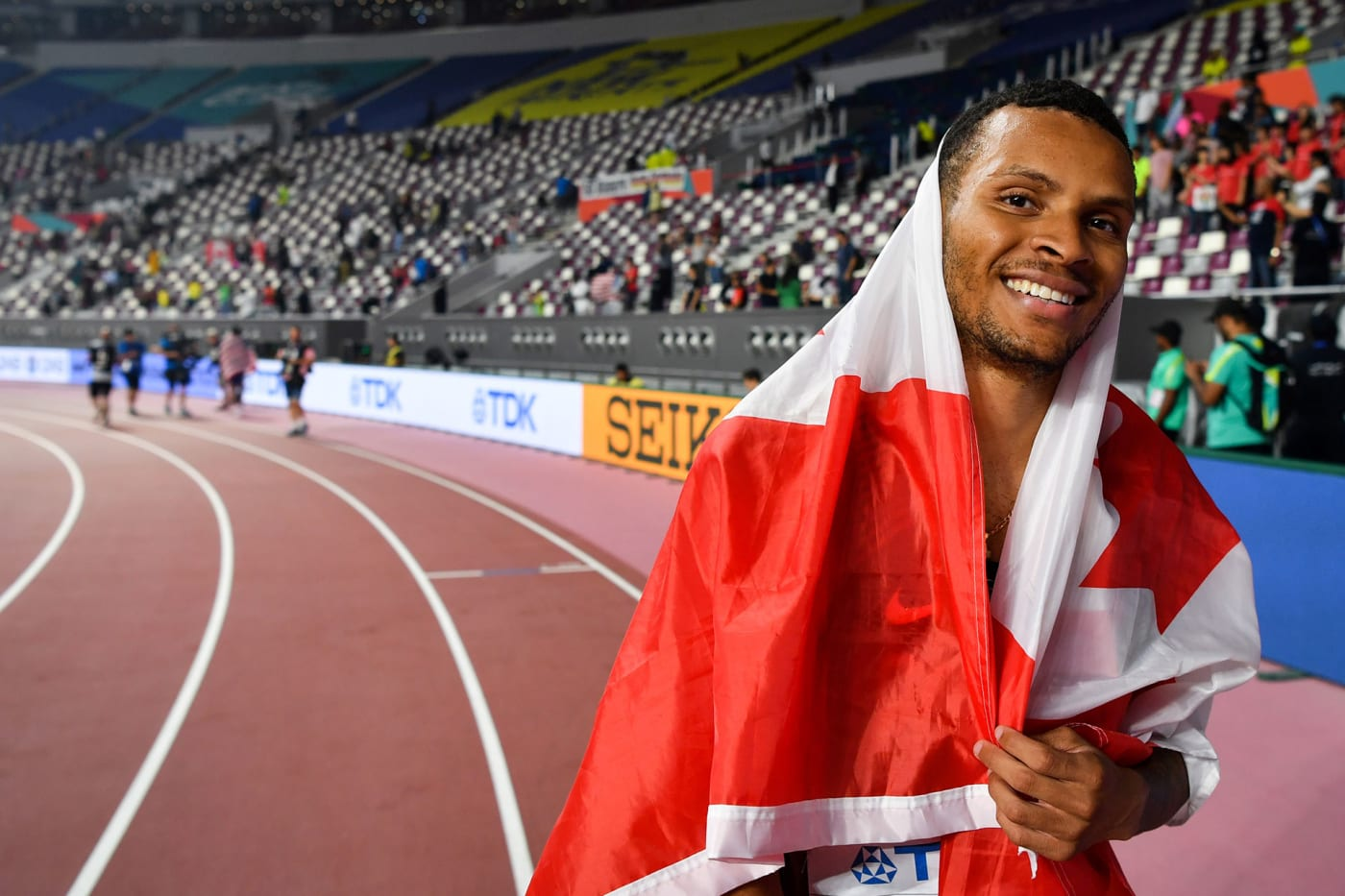 Canada's Andre De Grasse celebrates taking silver in the Men's 200m final at the 2019 IAAF Athletics World Championships at the Khalifa International stadium in Doha on October 1, 2019.