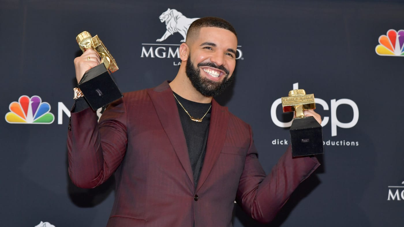 Drake poses with the awards for Top Artist, Top Male Artist, Top Billboard 200 Album