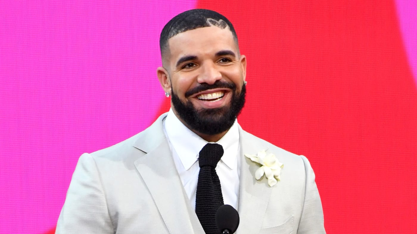 Drake, winner of the Artist of the Decade Award, and Adonis Graham speak onstage for the 2021 Billboard Music Awards.