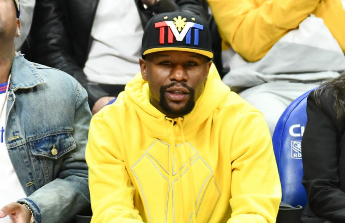 Floyd Mayweather Jr. attends a basketball game