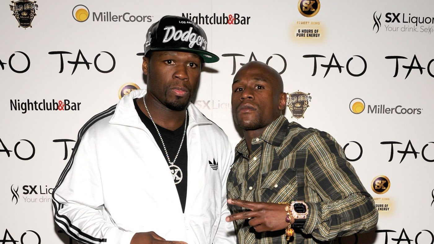 50 Cent (L) and boxer Floyd Mayweather Jr.