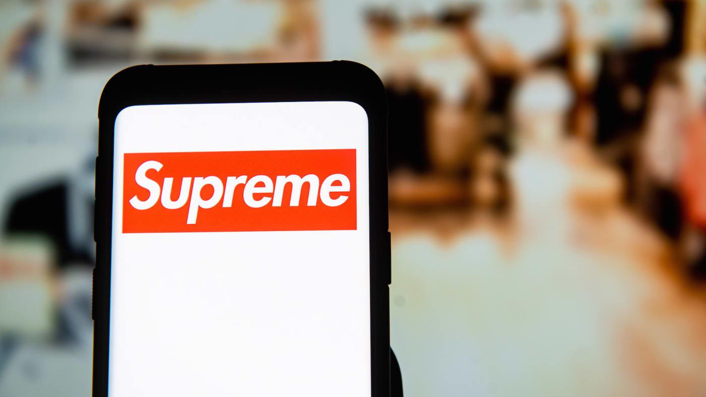 Supreme logo seen displayed on a smartphone