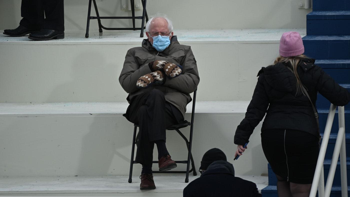 Bernie Sanders sits in the bleachers on Capitol Hill before Joe Biden is sworn in.