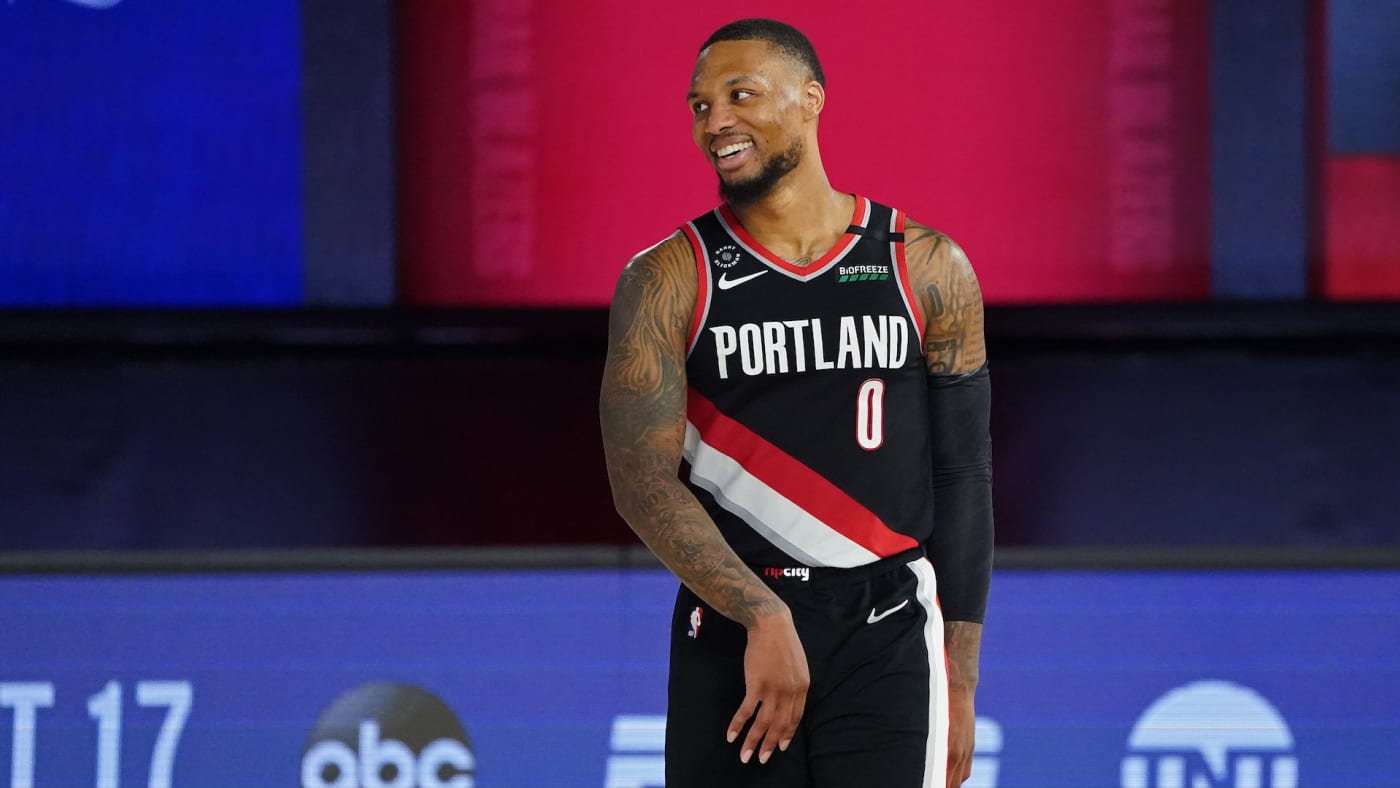 Damian Lillard smiles and celebrates after the Western Conference Play in Game.