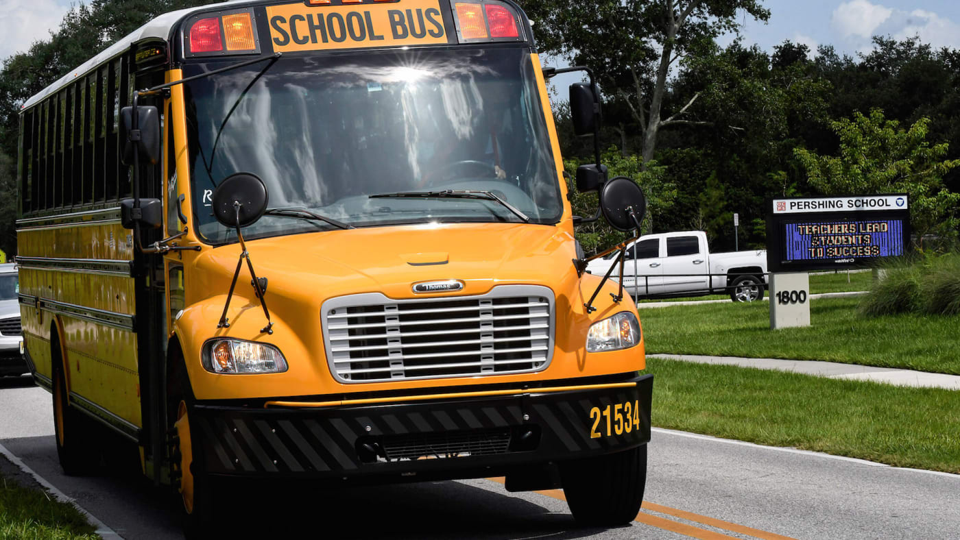 A school bus drives past Pershing School in Orlando. Students in all Orange County schools