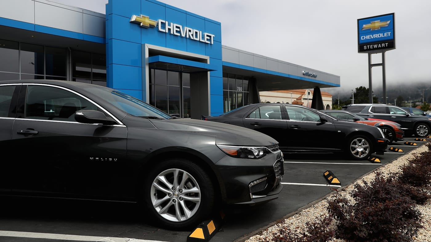 A Chevrolet Malibu is displayed at a Chevrolet dealership