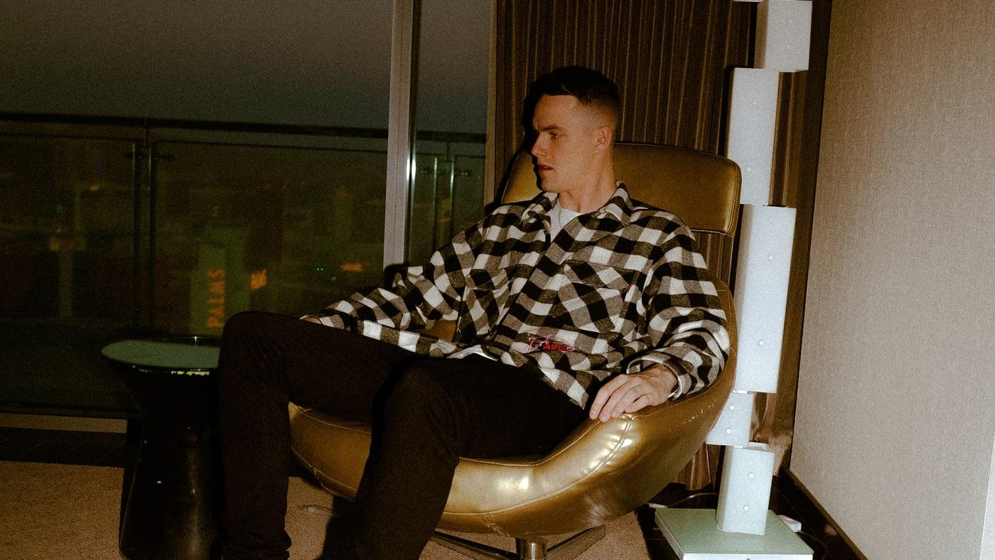 London Cyr sitting in a brown chair