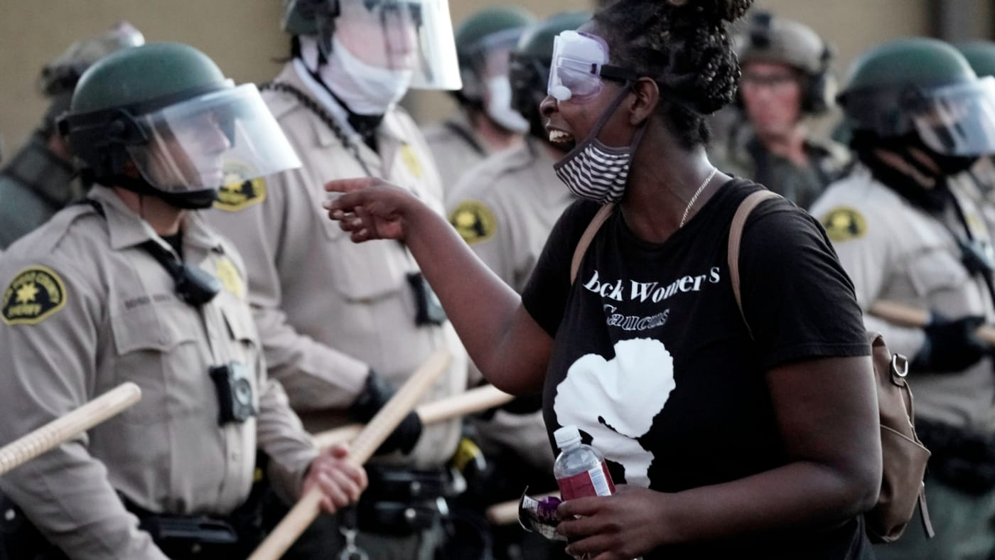 A demonstrator shouts at San Diego Sheriff Department deputies during a Black Lives Matter protest.