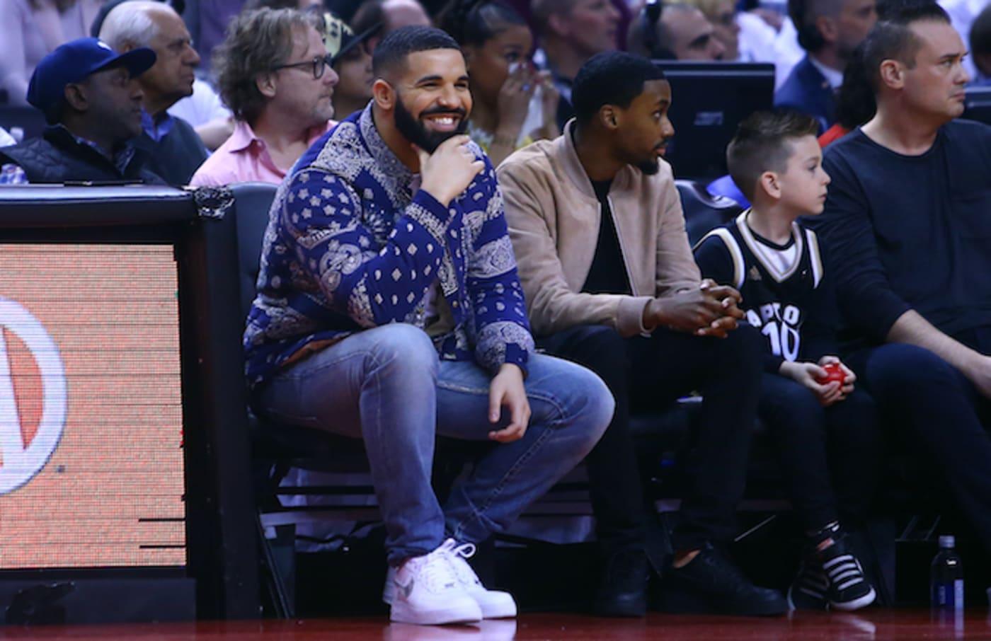 Drake sits courtside during 76ers/Raptors 2019 NBA Playoffs game. .