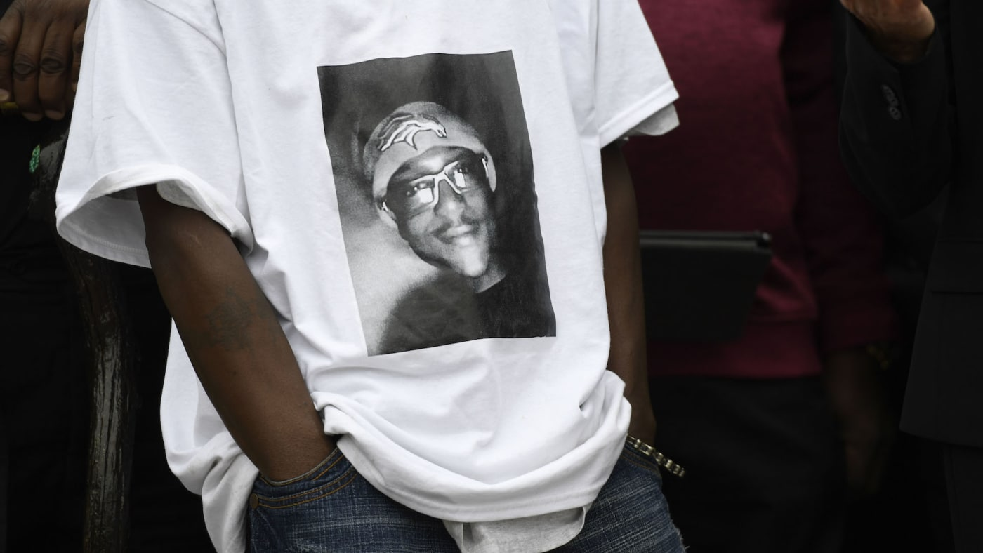 LaWayne Mosley, father of Elijah McClain, wears a t shirt with is son's picture on it.