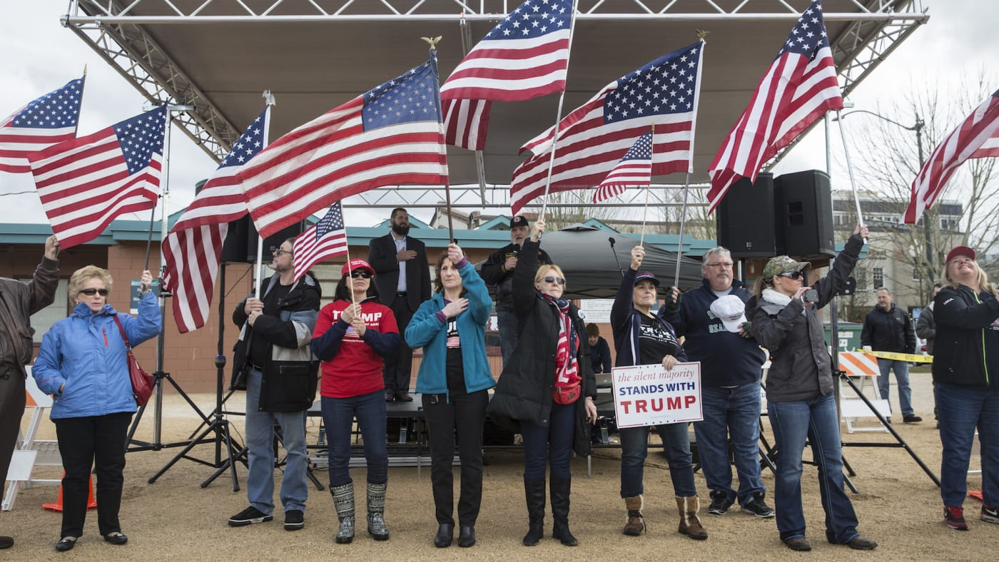 Supporters of U.S. President Donald Trump say the Pledge of Allegiance
