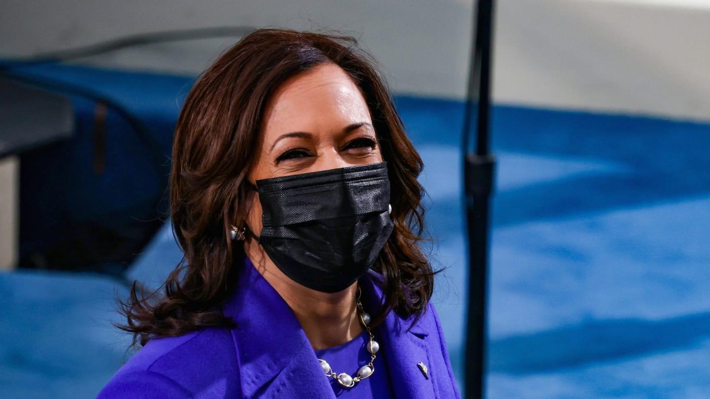 Vice President elect Kamala Harris looks on