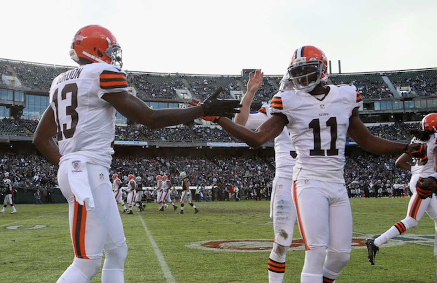 Mohamed Massaquoi and Josh Gordon during a game against the Raiders.