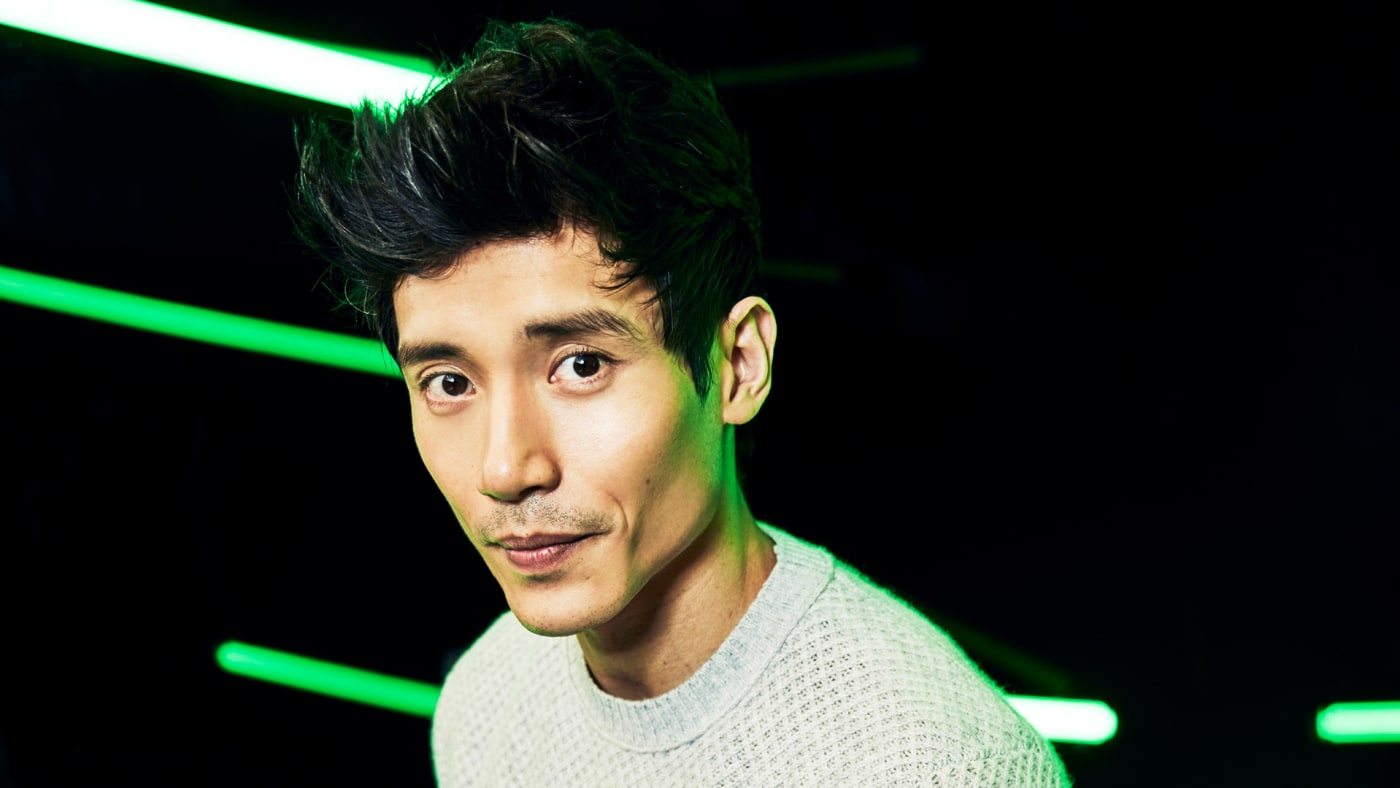 Manny Jacinto with green neon lights