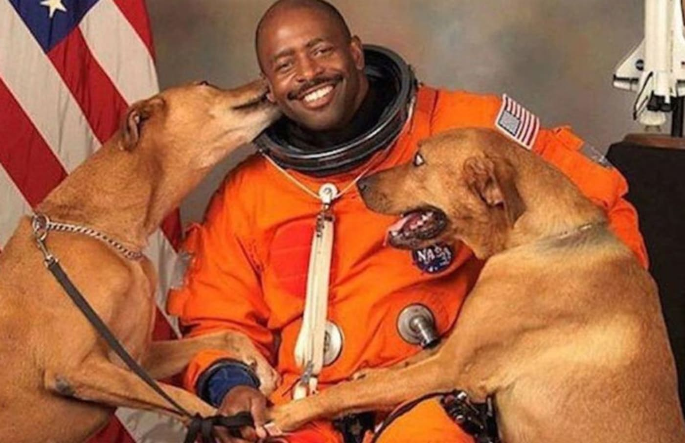Astronaut Leland Melvin with his dogs.