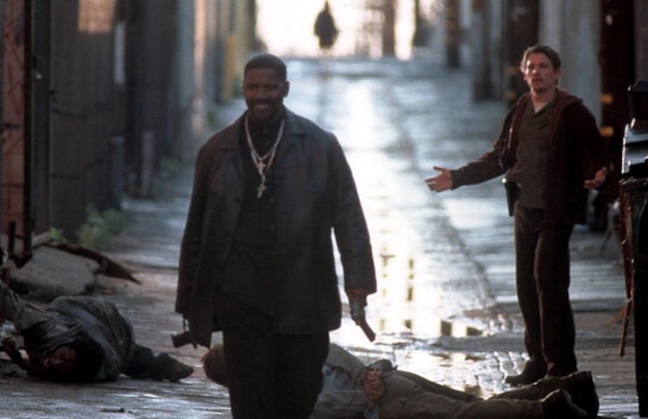 Denzel Washington walks away from Ethan Hawke in a scene from the film 'Training Day'
