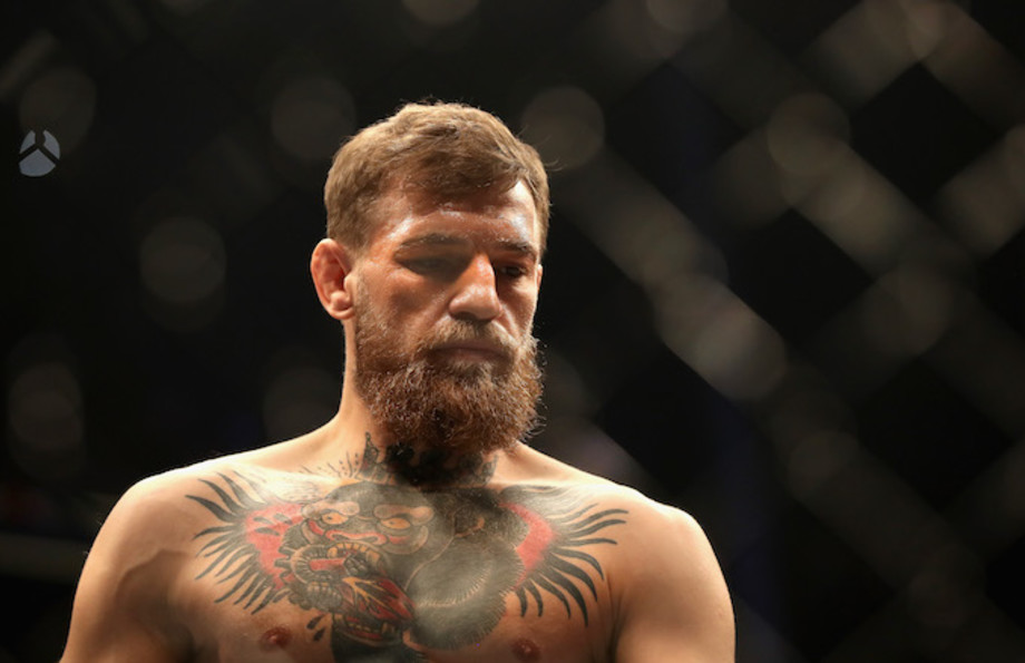Conor McGregor looks on in the octagon before competing against Khabib Nurmagomedov.