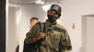 Kyrie Irving #11 of the Brooklyn Nets arrives to the arena prior to the game against the Milwaukee Bucks.