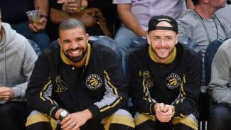 "Drake and Noah ""40"" Shebib smiling at a Toronto Raptors game"