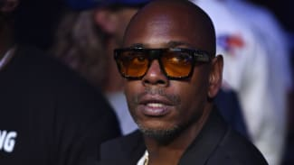 image of Dave Chappelle with glasses