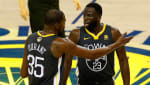 Kevin Durant talks with Draymond Green against the Cavaliers in the 2018 NBA Finals.