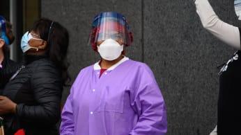 Medical personnel are seen outside NYU Langone Health hospital