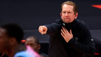 Nick Nurse pulling down mask during Raptors game