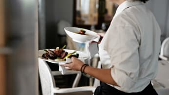 Waitress carrying dishes
