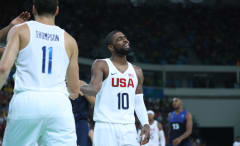 Kyrie Irving high fives his teammates as the U.S. plays France in 2016 Olympic preliminary round.