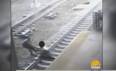 Cop saves man from train
