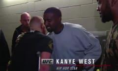 Conor McGregor hugs Kanye West at UFC 202.