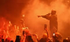 This is a photo of Kanye West performing.