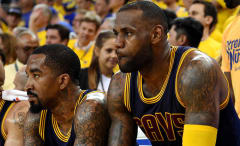 LeBron James and J.R. Smith sit next to each other on the bench during the 2016 NBA Finals.