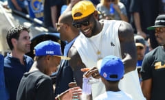 LeBron James watches a Los Angeles Rams game with his sons.