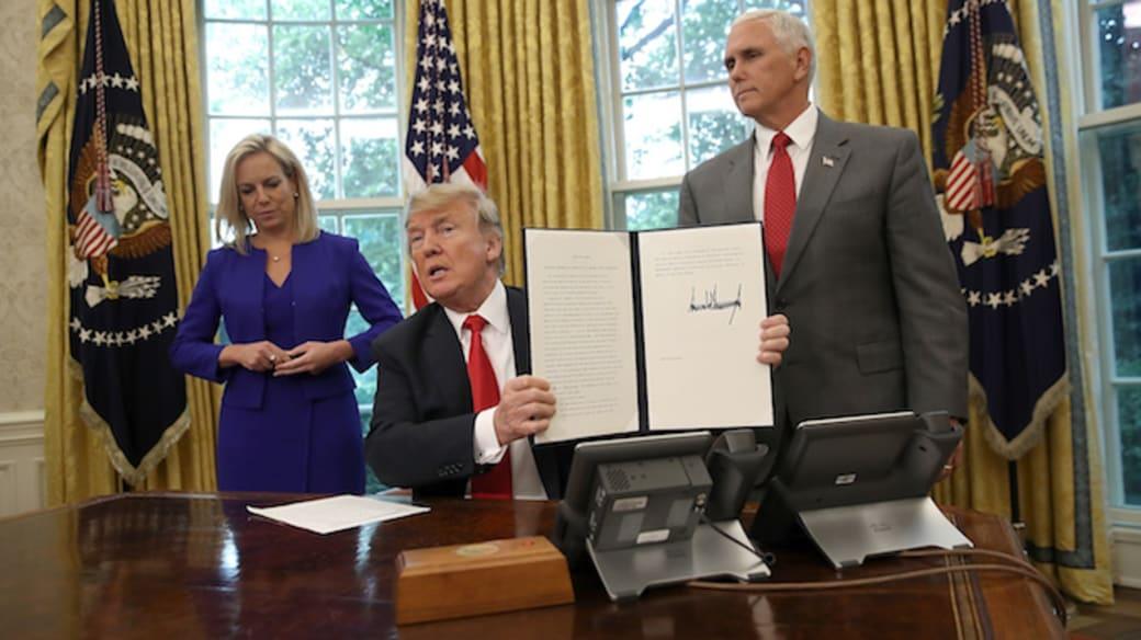 Donald Trump, Kirstjen Nielsen (L) and Mike Pence.