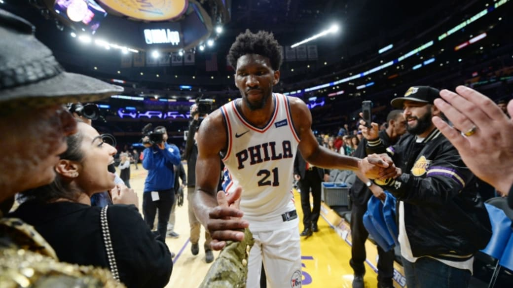 Joel Embiid celebrates win over Lakers.