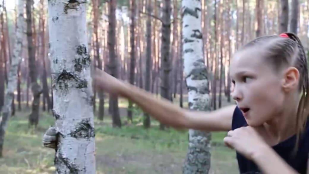 Evnika Sadvakasova destroying a tree