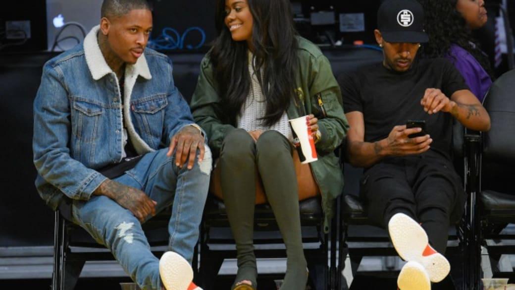 YG, Karen Civil, and Nipsey Hussle sit courtside at Lakers game.