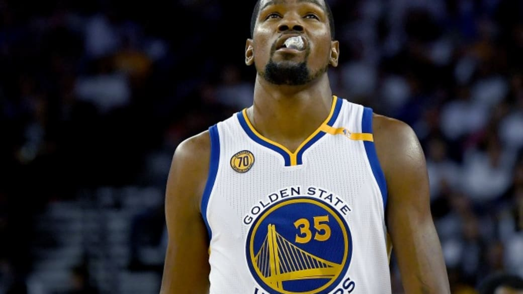 Kevin Durant grimaces during the Warriors' first game of the season.