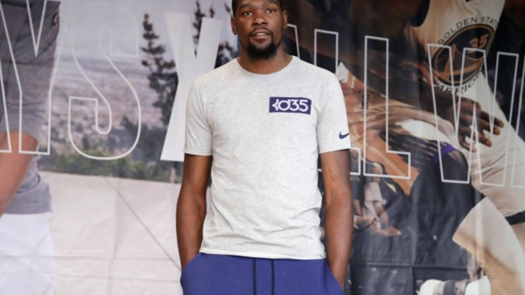 Kevin Durant speaks at an event.