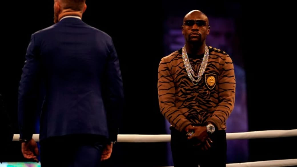Floyd Mayweather and Conor McGregor square off in the ring.