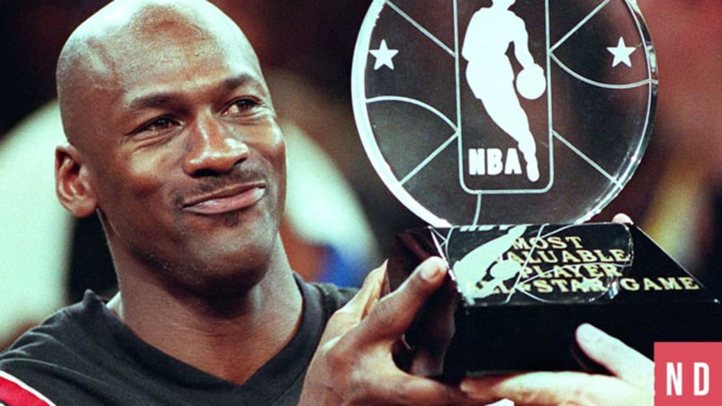 Michael Jordan holds up an All-Star Game MVP Trophy