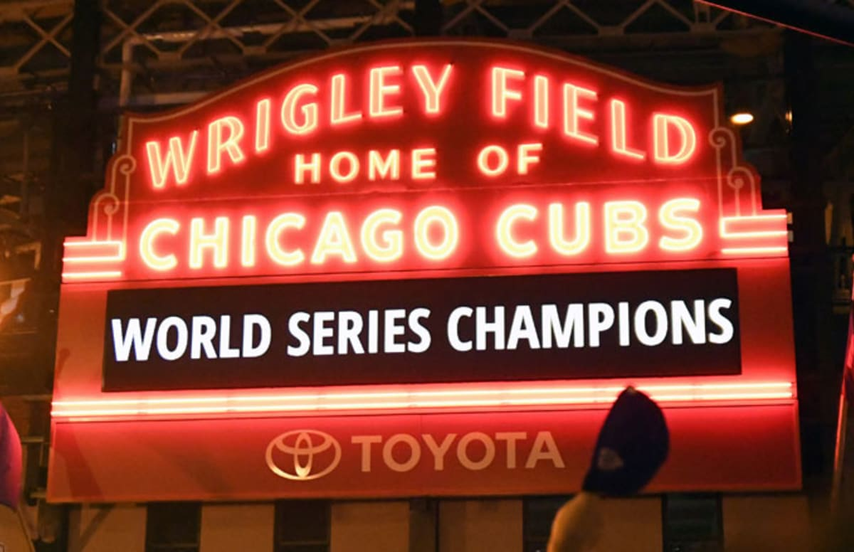 0db847174ac Watch This Cubs Fan Propose to His Girlfriend at Wrigley Field As She Holds  the World Series Trophy